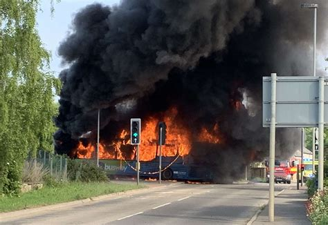 Fire after bus and car crash on guided busway between